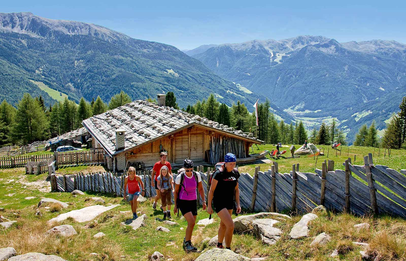 A group is hiking in the mountains around Lappago in Valle Aurina