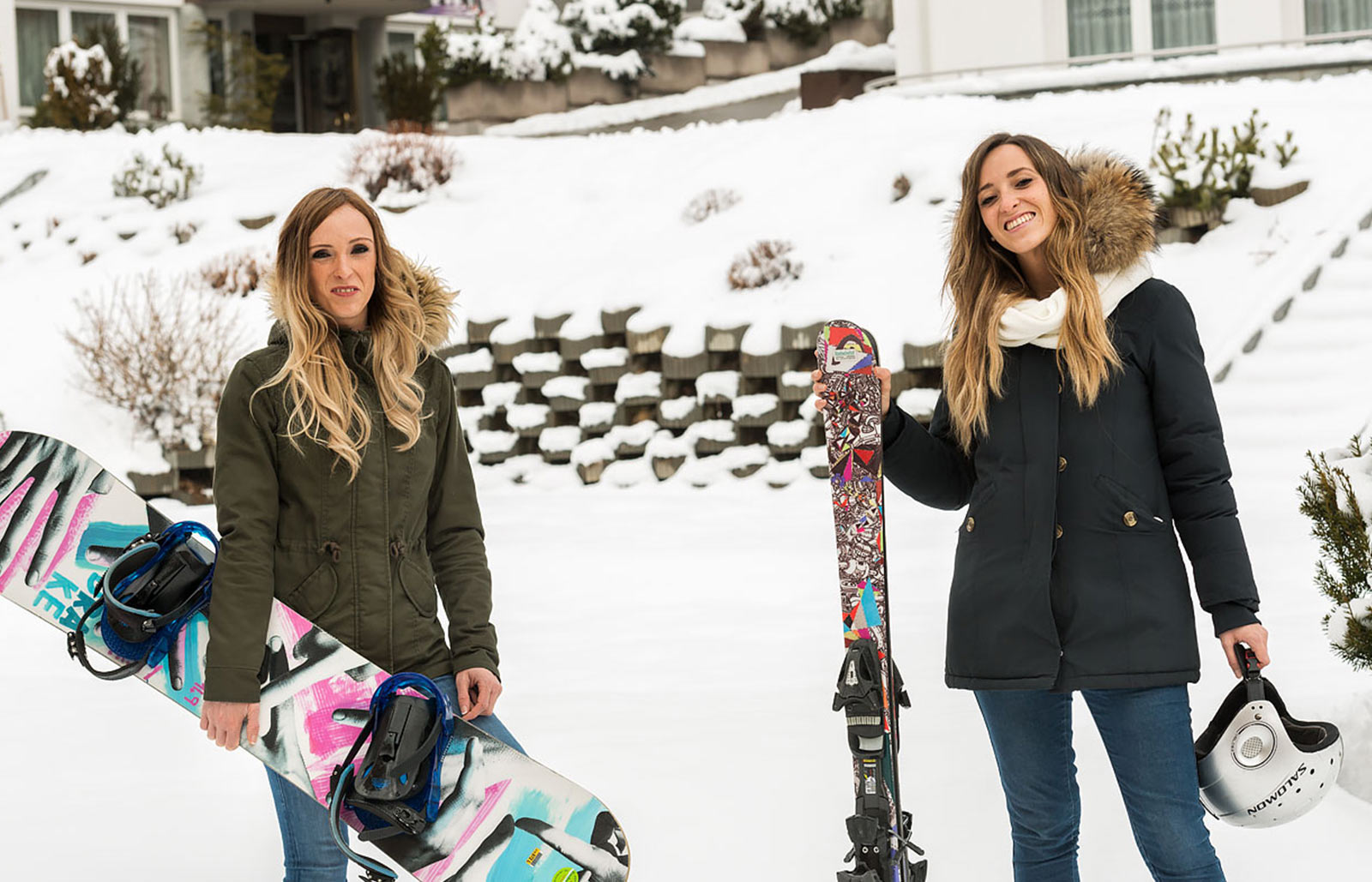 Two young ladies are happy to go ski in the Dolomites on the Speikboden with the rented equipment